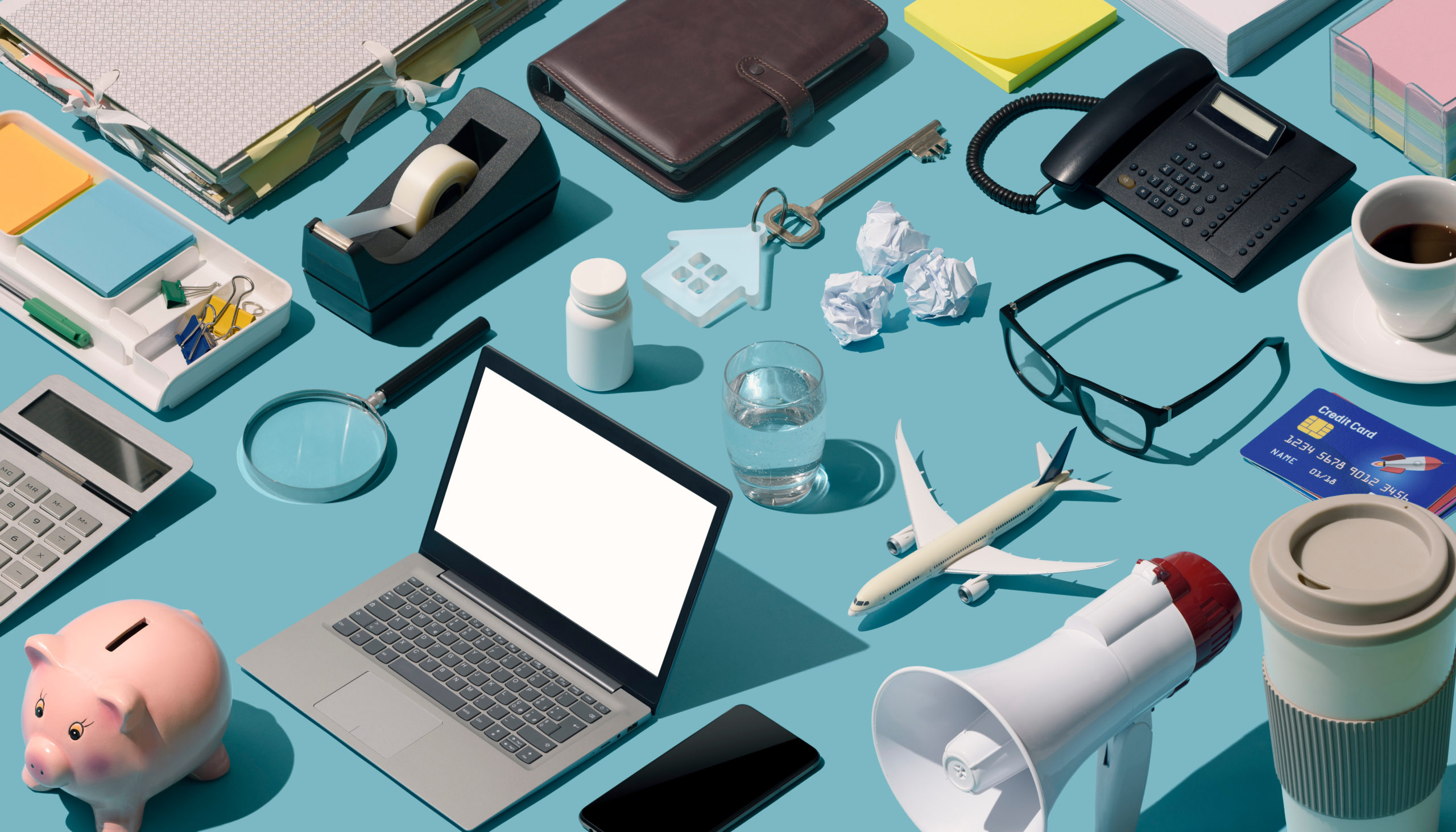 A working desk, but a little too much clutter. Some good organizing can reduce this to a manageable state.